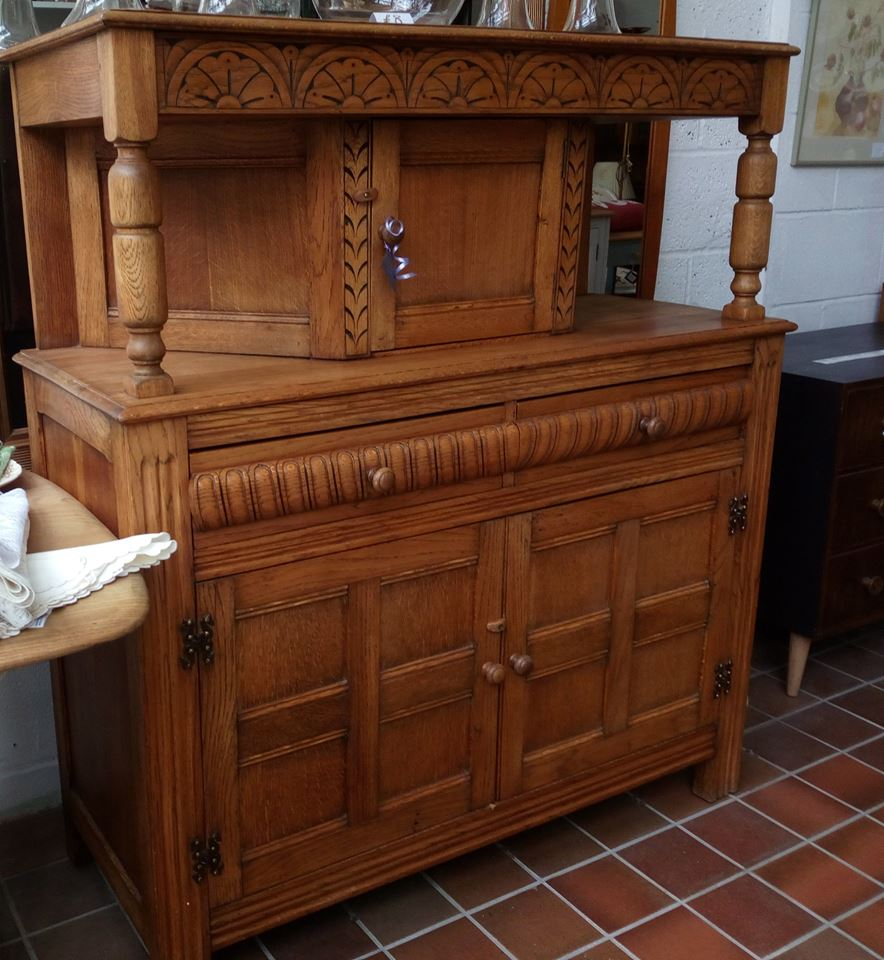 This vintage carved oak court cupboard has been stripped and waxed